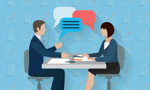 A flat illustration of two people sitting at a desk talking to eachother over paperwork